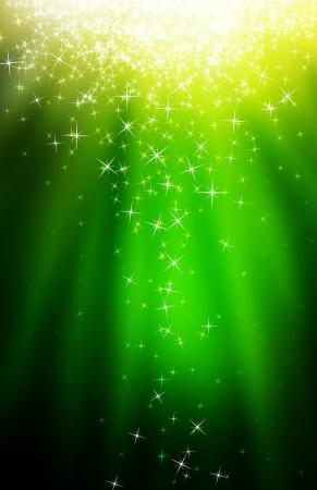 glitter stars descending on green light burst photo