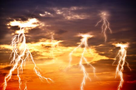 lightnings: Heavy clouds bringing thunder, lightnings and storm.
