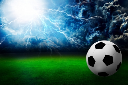 lightnings: football field soccer stadium on the green grass , thunder sky  Stock Photo