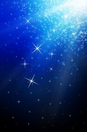 sterrenhemel: sneeuwvlokken en sterren aflopende, blauw licht Stockfoto