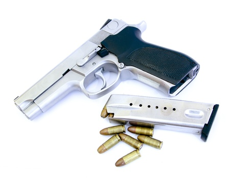 magnum: bullets and Semi-automatic gun isolated on white background Stock Photo
