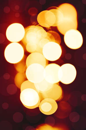 blurred lights: Circles on red tone background. Stock Photo