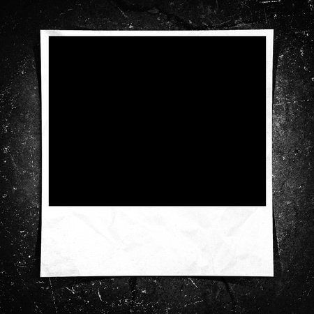 taped: A blank instant photo taped to a grunge background. Stock Photo