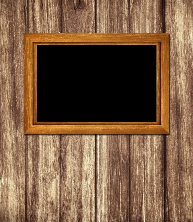 Vintage wooden frame on wood background photo