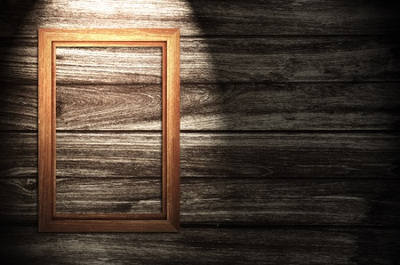 photoframe: wooden photo frame on old wooden wall  Stock Photo