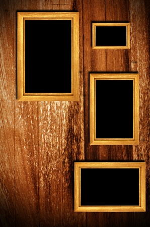 Vintage wooden frames on wood background photo