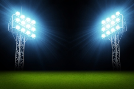 soccer field: Green soccer field, bright spotlights, illuminated stadium