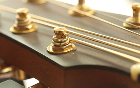 guitar tuner: Close up of tuning peg on acoustic guitar headstock Stock Photo