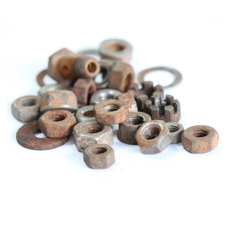 group of old rusty nuts and bolts isolated on white background photo