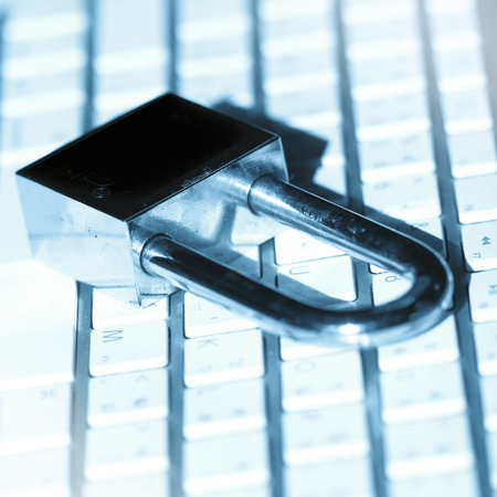 A padlock on keyboard. Data security and protection. photo