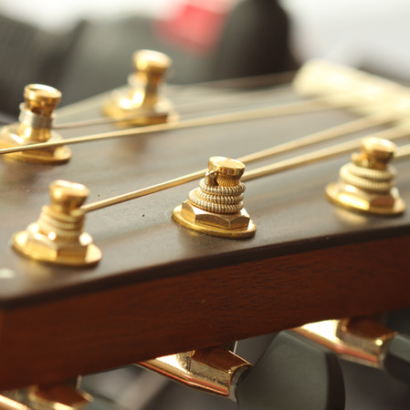 pegheads: Close up of tuning peg on acoustic guitar headstock Stock Photo