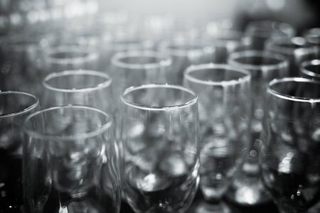 a lot: empty glasses on a banquet table close-up Stock Photo