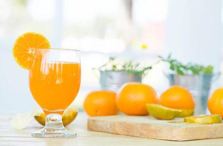 fruits juice: Orange juice in glass , fresh fruits on wooden background