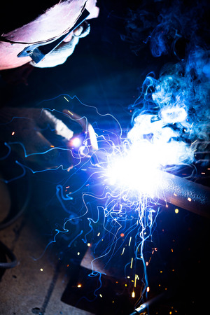 welding metal and sparks Stock Photo