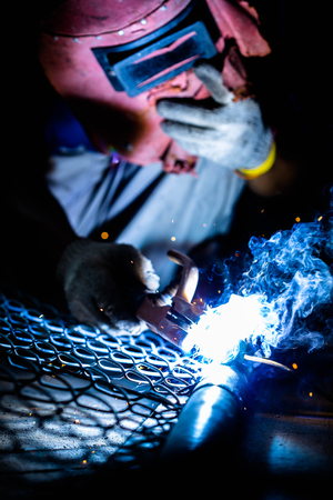 skilled labour: welding metal and sparks Stock Photo