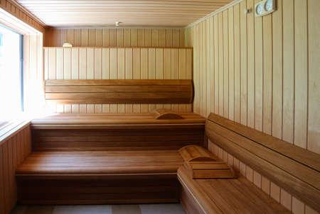 finnish bath: Luxury wooden Bathhouse with a window, sunlight. Elegant sunny wooden sauna interior with a window.