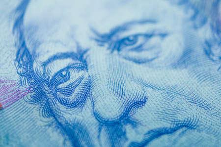 Czech republic currency koruna, banknote pattern background, close up. Photo depicts Czech cash shiny korun czk metal coins, close up, macro view.
