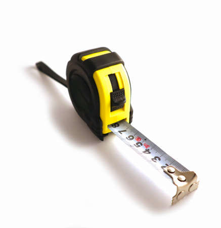 Professional yellow measure tape, engineering tool.