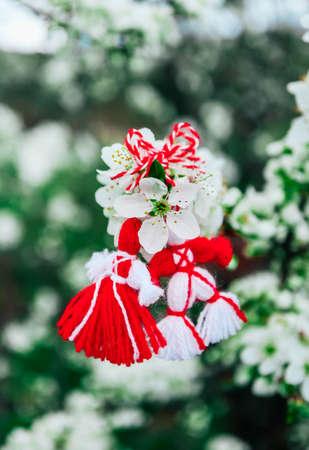 Bulgarian traditional spring decor martenitsa on the blossom tree background. Baba Marta holiday. Stock Photo