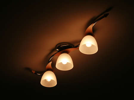 Three lamps on a ceiling photo