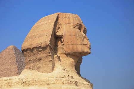 The great egyptian Sphinx of Giza with ancient pyramids on the background photo