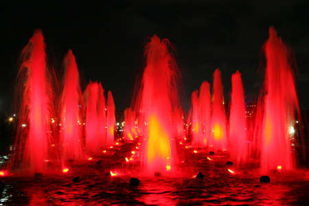 Flame-looking red fountain at night (urban scenics) Stock Photo - 1268479
