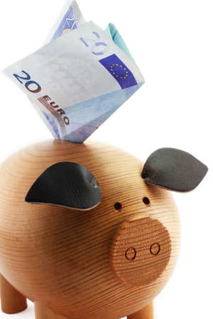 Piggy bank with 20 euros note isolated on white background photo