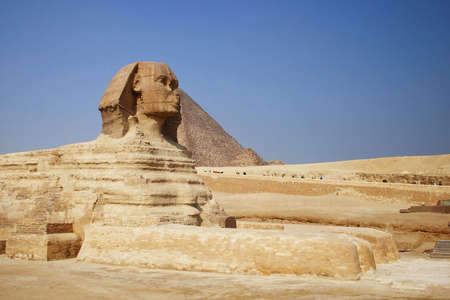 The great egyptian Sphinx of Giza with ancient pyramids on the background Stock Photo - 2632694