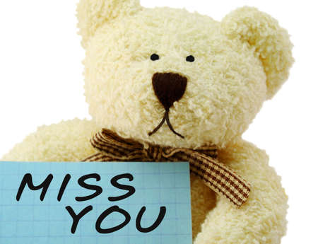 Front view of teddy bear toy with Miss you note, isolated on white background