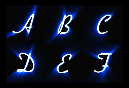 letters of the alphabet on a black background photo