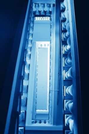 old rung of the ladder in the blue glow of the spiral Stock Photo - 15989002