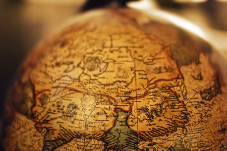 europe vintage: Close up of old vintage globe with old handmade map soft colors Stock Photo