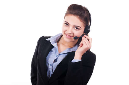 Pretty girl with headset smiling during a telephone conversation photo