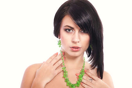 Beautiful young woman in beautiful jewelry photo
