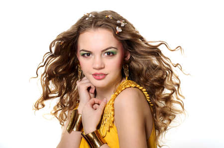 Young beautiful girl with blond curly hair photo