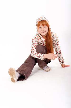 Little redheaded girl on a white background photo