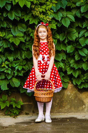age 5:  Girl in a beautiful dress in cherry garden Stock Photo