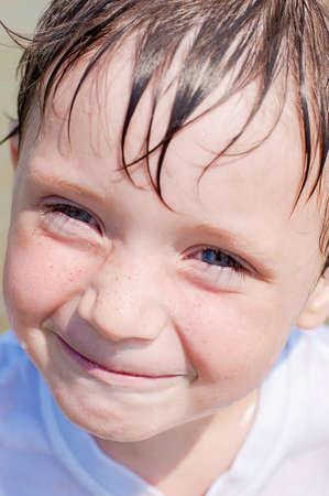 Little boy in the sea water photo