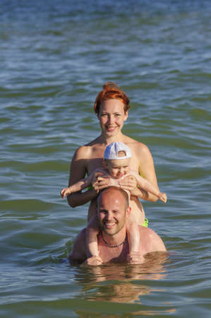 Family in sea water swimming photo