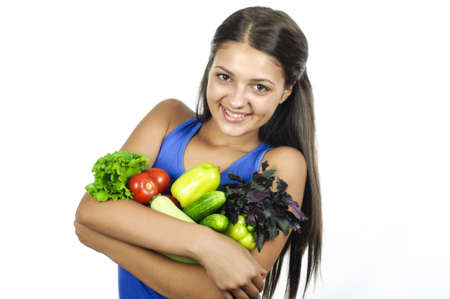 Girl with vegetables in studio on white background photo
