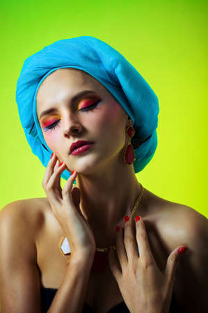 Beautiful girl in a turban in beautiful earrings and necklace photo