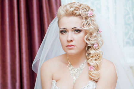 Young beautiful bride with blonde curly hair photo