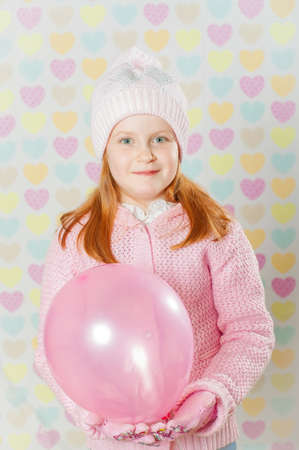 pink hat: Little girl in a pink hat and a sweater Stock Photo