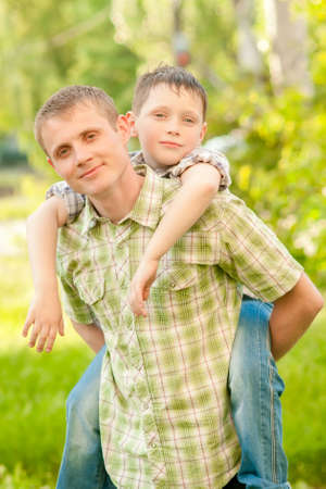 30 34 years: father and boy on a summer nature Stock Photo