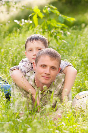 30 34 years: Father and boy in nature summer
