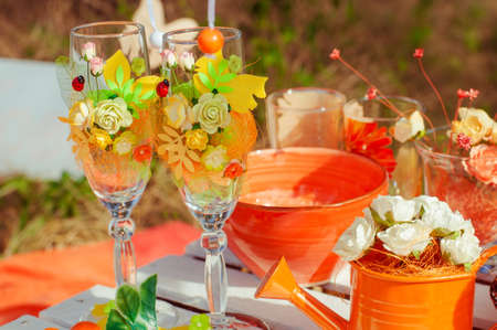 Decorated picnic with oranges  in the summer garden photo
