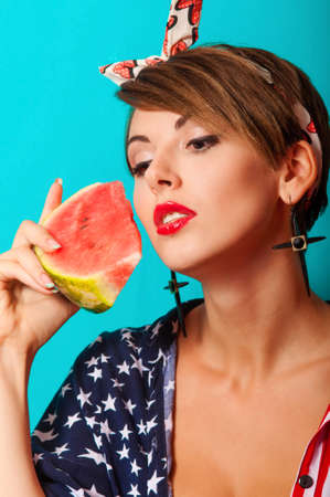 Young beautiful girl with watermelon in hands photo