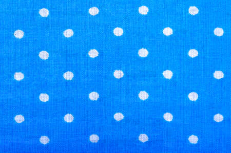 Blue cotton fabric texture with dots photo