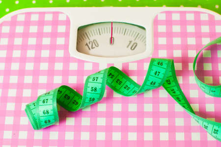 The green centimeter and pink mechanical scales Stock Photo - 31868872