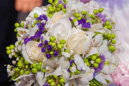 Wedding bouquet of beautiful purple flowers photo